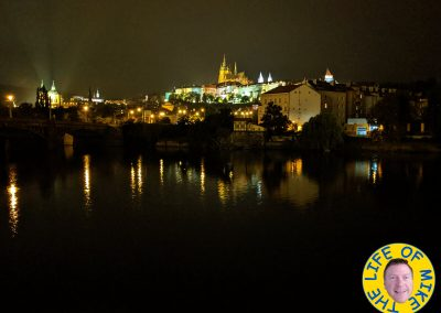 Prague Castle at night with river reflections