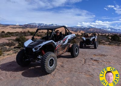 Eric on his UTV with the La Sal Mountains behind